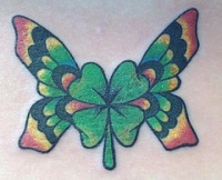 butterfly wing clover tattoo